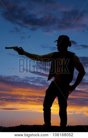 Silhouette Of A Cowboy With A Pistol Pointed To Side