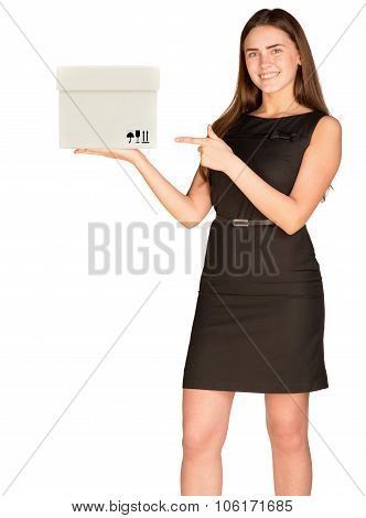 Businesslady pointing at white box