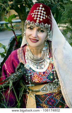 Portrait beautiful lady in the Armenian folk clothing
