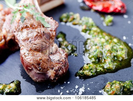 Grilled meat, mutton, lamb rack with fresh salad.