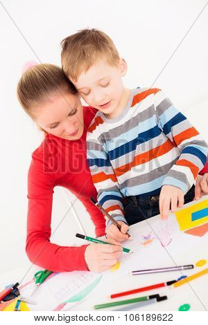 Mother and her son drawing
