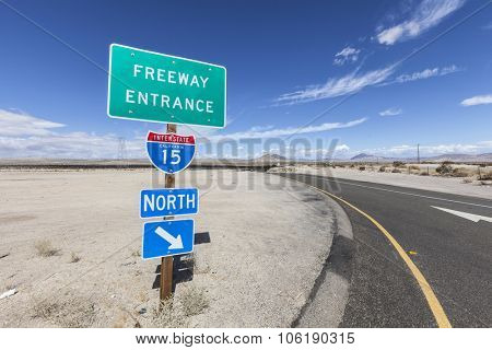Interstate 15 on ramp sign in the California Mojave desert.