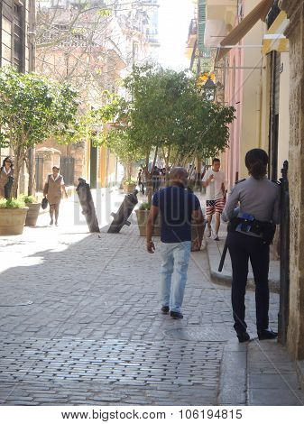 Cuban Policewoman In The Corner Of Street