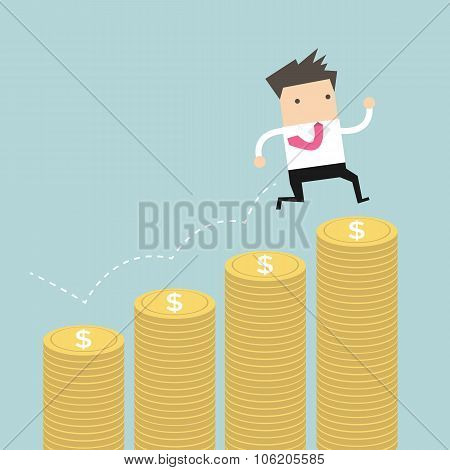 Businessman jumping on the money step