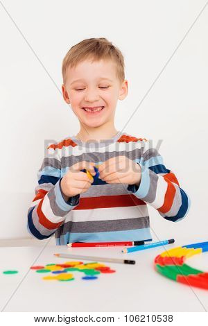 Laughing boy with game