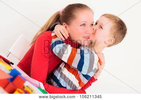 Child kising his mom