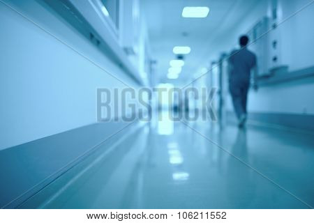 Moving human figure in the hospital corridor
