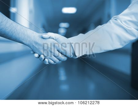 Handshake In The Hospital Corridor