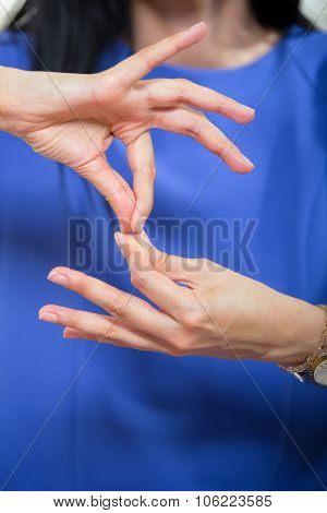 Deaf woman using sign language, close up