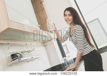 Beautiful young woman in kitchen room