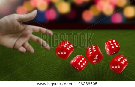 Male hand throwing dice on green felt poster