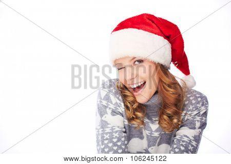 Flirty girl in Santa cap and sweater