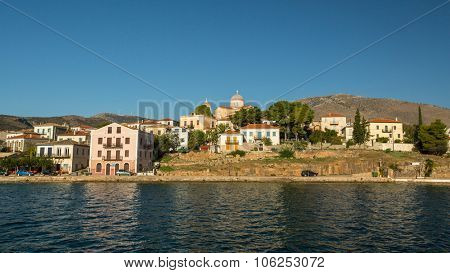 GALAXIDI, GREECE - CIRCA SEP, 2014: View from the sea of buildings and Ortodox temple. Galaxidi is a small port situated on a natural double harbour surrounded by mountains. Population 2,989 human.