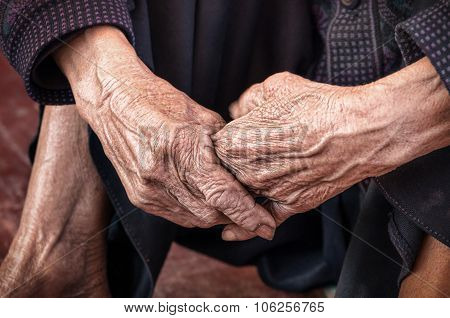 Dramatic hands of an old unidentified Person poster