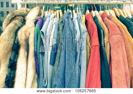 Vintage Second Hand Clothes Hanging On Shop Rack At Weekly Flea Market - Hipster Wardrobe Sale Conce