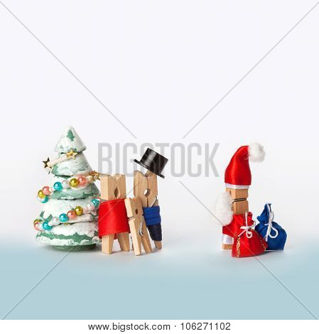 Wooden clothespin family with kid and Santa Claus, christmas tree