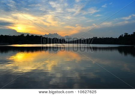 Sunset and clouds and reflections on a reservoir