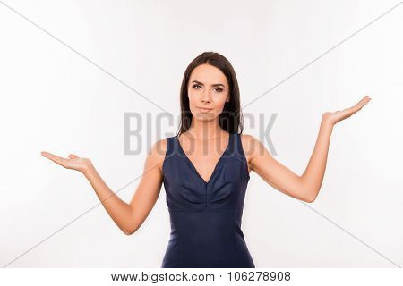 Serious Pretty Young Woman Choosing Between Two Options
