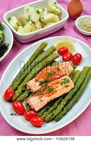 some salmon steak with organic green asparagus poster