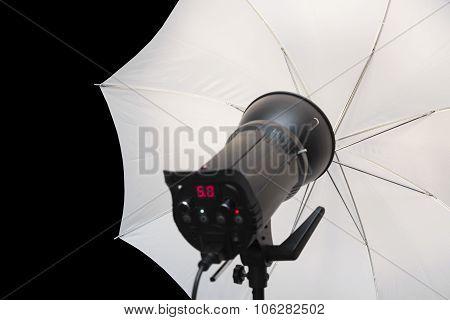 Photography Studio Strobe Flash With White Umbrella And Black Copy Space