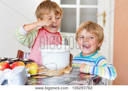 Two Little Kid Boys Baking Apple Cake Indoors