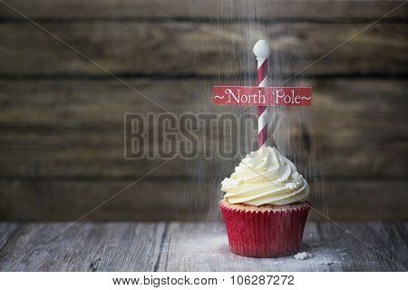 Cupcake with North Pole sign