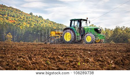 Rish, Bulgaria - Octomber 26Th, 2015 Ploughing A Field With John Deere 6930 Tractor. John Deere 8100