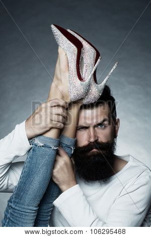 Man Holding Legs Of Woman