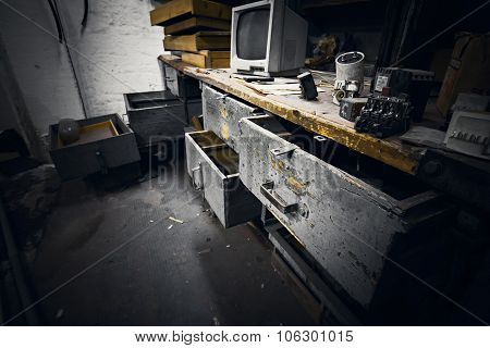 Dirty Office Furniture In An Abandoned Factory