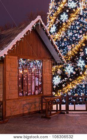 Christmas Tree And Wooden Santa's House