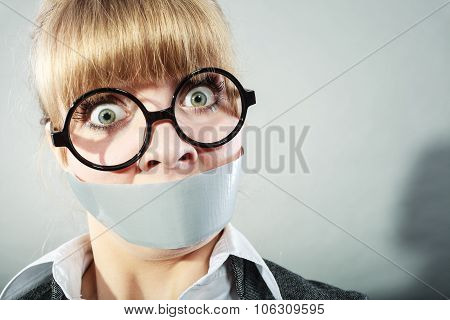 Scared Woman With Mouth Taped Shut. Censorship.