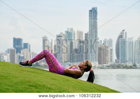 Woman Training Abs And Working Out In City Park