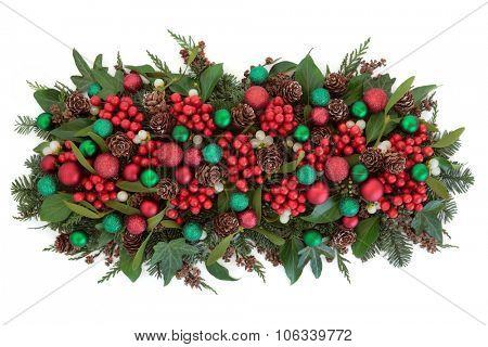Christmas bauble decorations, holly, mistletoe, ivy, pine cones and traditional greenery over white background. poster