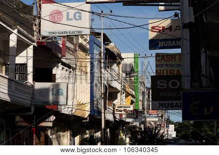 Billboards And Communications Cables On Manado Street