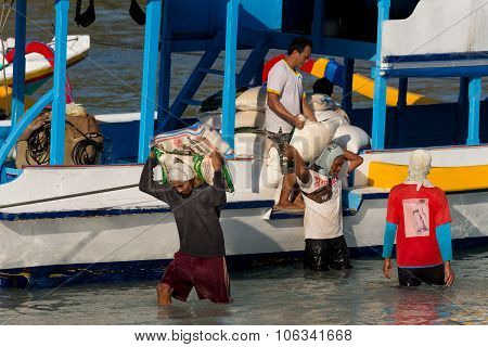 Men Transports Cargo From Ship