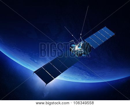 Communications satellite orbiting Earth with sunrise in space (Texture maps for 3D render furnished by NASA)