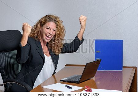 Cheering Stylish Young Businesswoman With A Lovely Smile