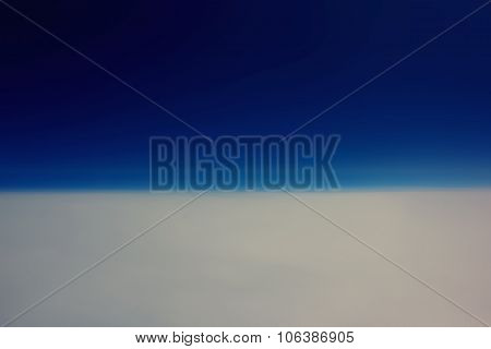 View from the plane of a blue sky and white clouds