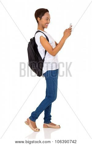 cheerful african university student using smart phone isolated on white background