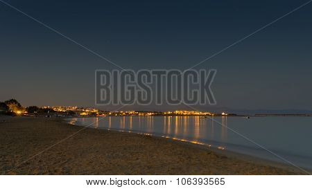Night view of Golden beach or Xrisi Akti in Paros island in Greece.