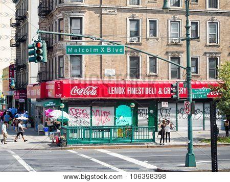 NEW YORK,USA - AUGUST 20,2015 :Urban scene next to Lenox Avenue at Harlem, New York City