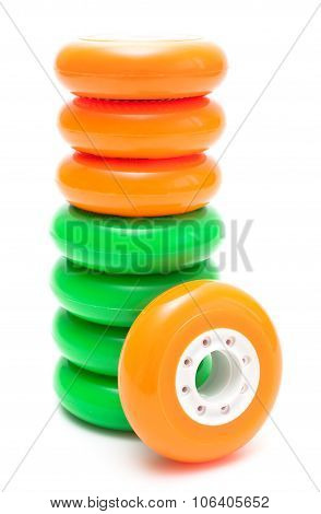 Orange and green wheels isolated over white