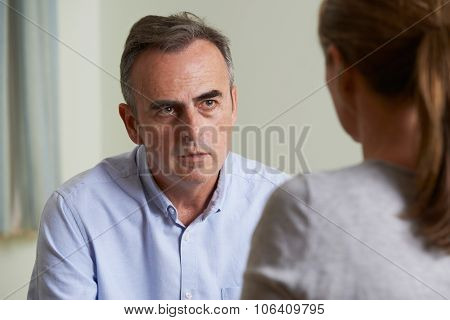 Depressed Mature Man Talking To Counsellor