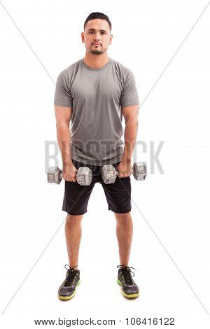 Hispanic Man Lifting Dumbbells