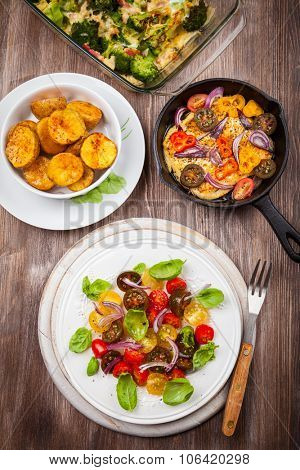Tomato salad with grilled cheese and oven backed potatoes