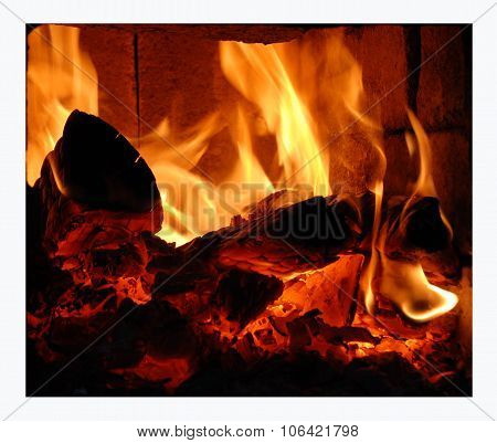 In the furnace burning birch firewood. Bright flames licking the walls and ceiling of the oven. poster