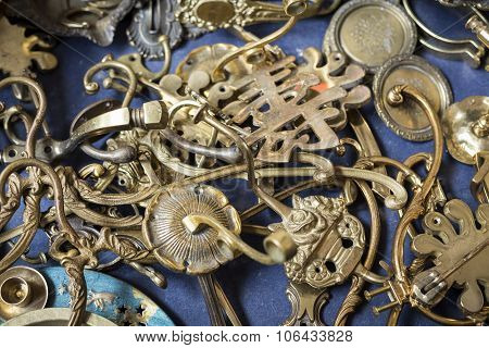 Bunch Of Many Old Brass Door Mountings On A Flea Market