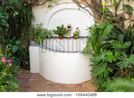 Tiled Well Or Fountain In Courtyard In Cordoba Spain