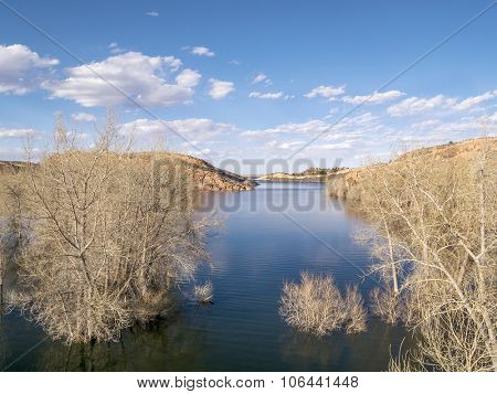 aerial view of Horsetooth Reservoir in Fort Collins, Colorado - early spring scenery with high water level and submerged cottonwood trees