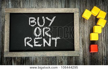Buy or Rent? written on chalkboard
